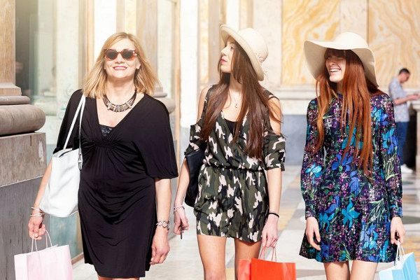 Three friends or mum with daughters go shopping in Naples in Italy.