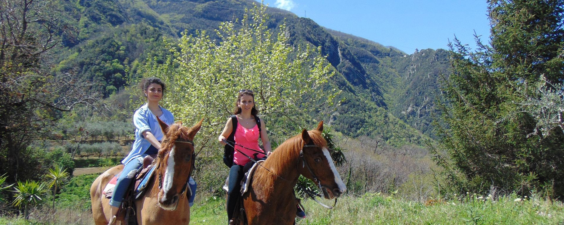 Two girls riding a horse in the Vesuvius National Park
