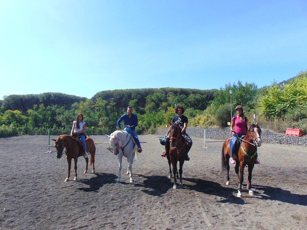 Tourist group riding a horse into the Vesuvius National Park