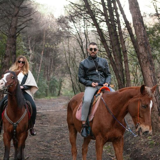 Couple riding a horse in the Vesuvius National Park