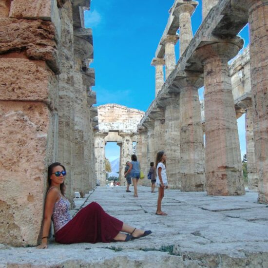 Girl posing in Paestum Temple