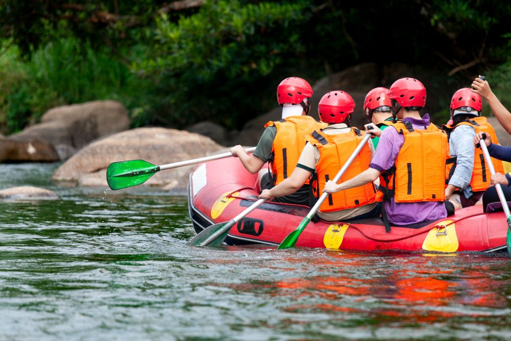 Young person rafting on the river, extreme and fun sport at tourist attraction natural park Campania