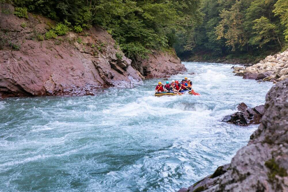 Group of turists rafting on the river, extreme and fun sport at tourist attraction natural park Campania