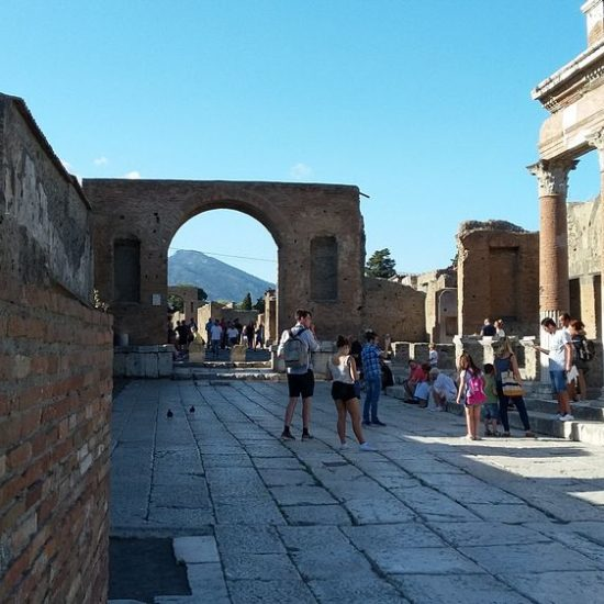 People standing in the foro of Pomepii Ruins