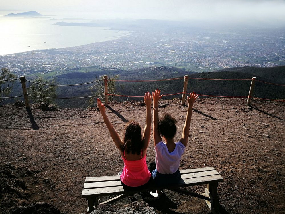 Two girl on the top of Mt. Vesuvius enjoying the view