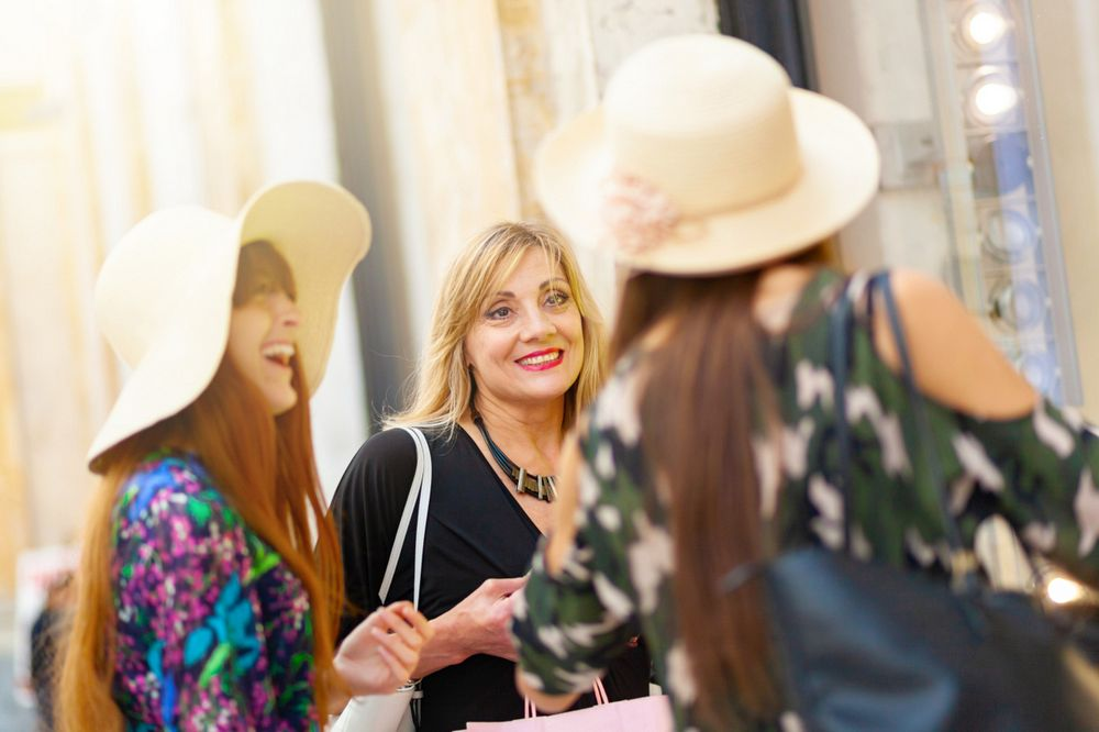 Three friends and mum with daughters go shopping in Naples