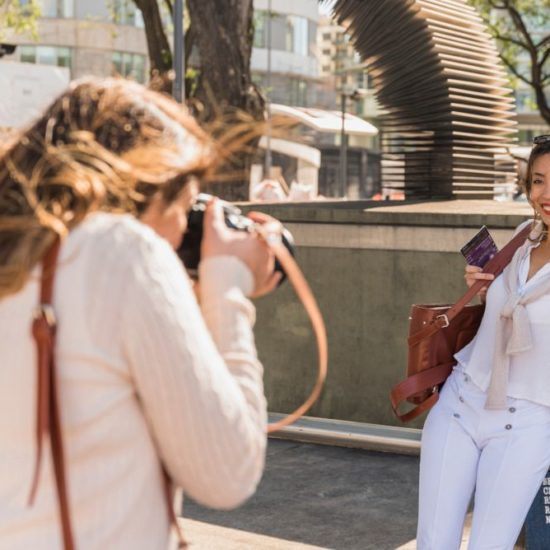 Vacation photographer taking picture of a client
