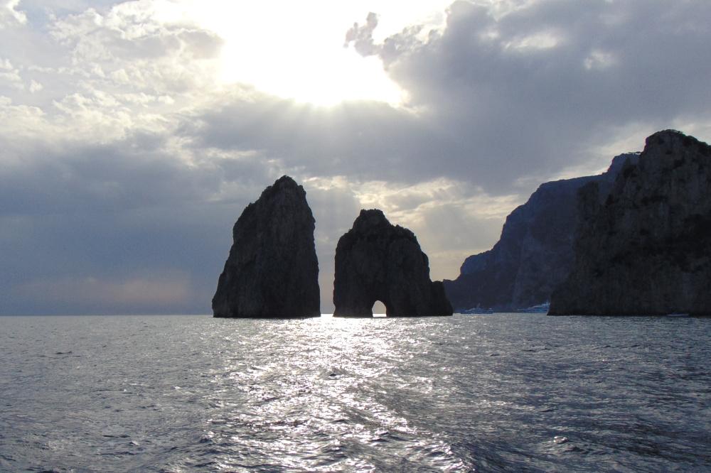 The view of Faraglioni at sunset, in Capri, Italy