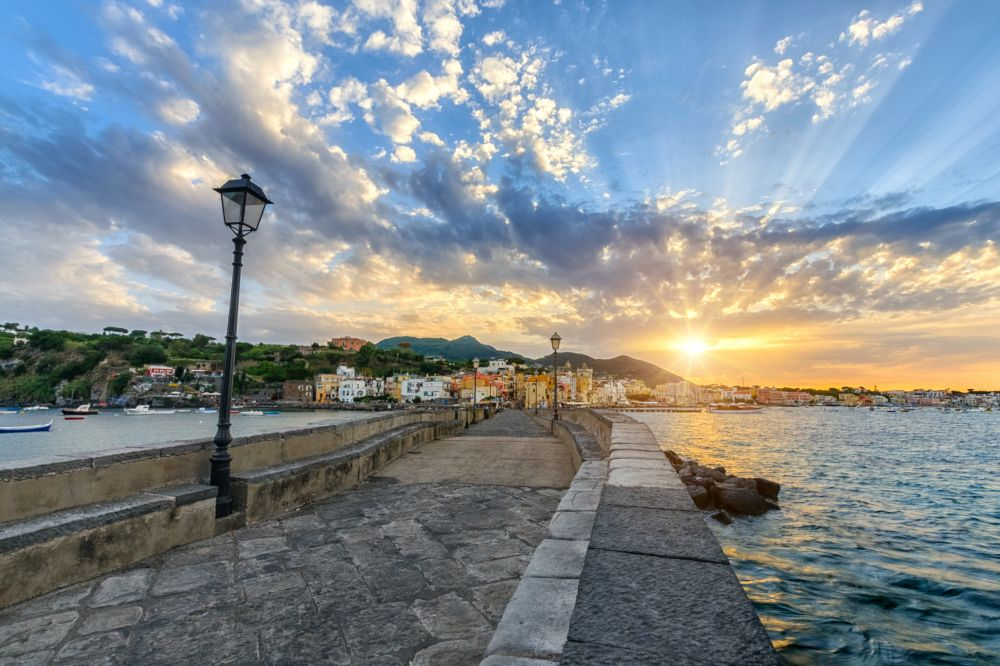 Evening cityscape of Ischia at sunset, town in the Metropolitan City of Naples, Italy