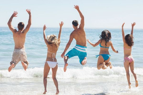 Young people enjoy the summer at Naples beach in Italy